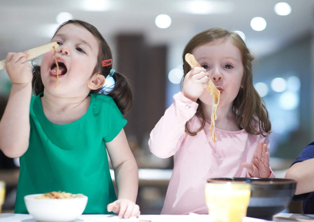 Kids eating with chopsticks